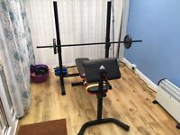 Adidas multi function workout bench with cast iron/plastic weights.