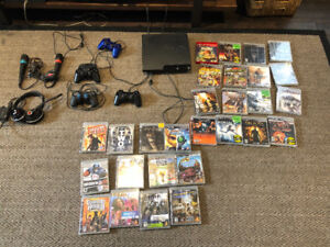 PS3 slim 120gb - 28 games - 4 controllers - turtle beach headset