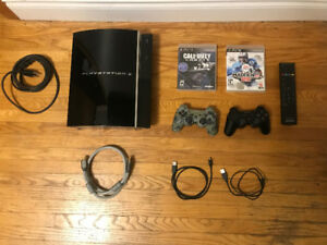 Sony PlayStation 3 with 2 Controllers and Games