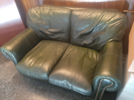 Sofa. Dark green leather with stud detail