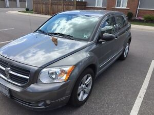 2011 Dodge Caliber with winter tires included.