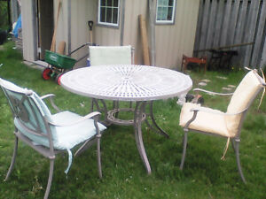 Cast metal 4 foot diam. patio table and 4 chairs