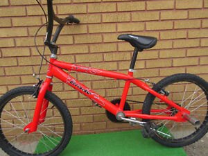 "red mountain bike (BMX).tire size 20""',like new no rust London Ontario image 1"