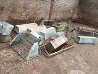 Twelve four feet galvanised feeders . Sheep cows horses