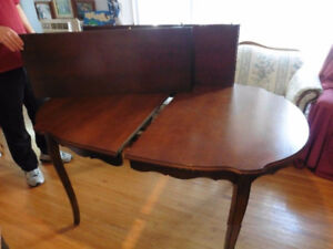 Sold wood table with 2 leafs (no chairs) $35