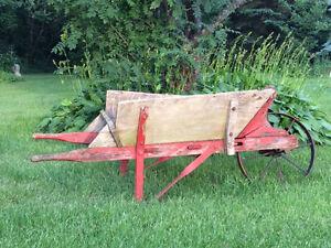 Wooden wheelbarrow.