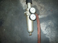 Air regulator with filter and water removal