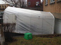 12'x8' Tempo car shelter with straps.