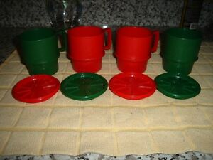 4 TUPPERWARE MUGS AND LIDS