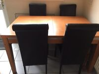 Solid extending dining table and 4 chairs