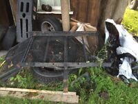 Rack for lawn mower or snowblower