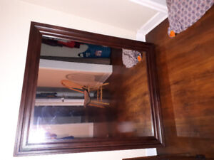 Very large mirror with wood frame.