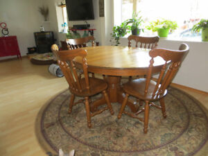 Real solid oak dining room table and six chairs