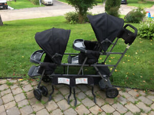 Joovy double stroller with toddler sit and stand.