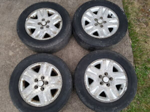 Four 225/60R16 All Season tires and alloy rims forsale