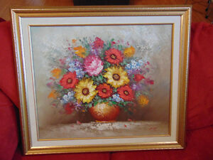 Signed oil painting of flowers in vase
