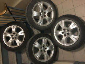4 mags jantes rims 16po 5x100 original toyota en bonne condition