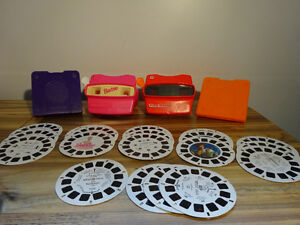 Two View-master 3D viewers, 19 reels and 2 cases for the reels