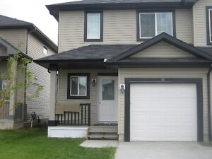 *** STONES THROW TO THE DOW CENTER...1/2 DUPLEX IN FORT SASK***