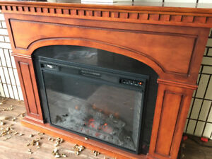 Electric fireplace with mantle/stand