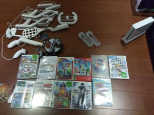 Nintendo Wii with accessories, guitar, keyboard, microphone