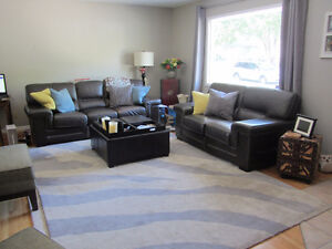 Beautiful high end leather 2 piece couch set...sad to sell!