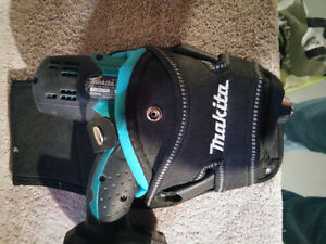 Makita tool holder for $20. Drill not included.