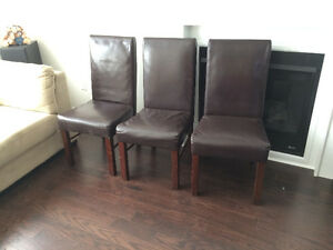 set of three leather parsons chairs