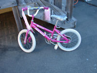 Girl's bike with training wheels And helmet