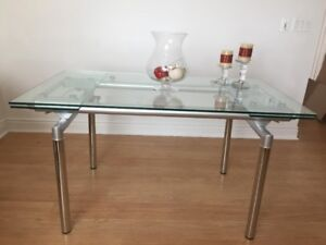 polished stainless still / glass , extendable dining table