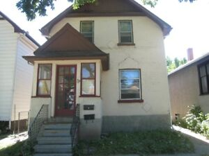 Two storey house featuring 6 bedrooms / 1 and a half bathrooms.