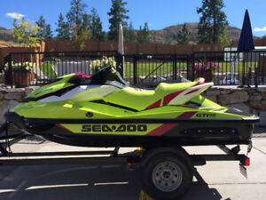 Two 2015 BRP Sea Doo's and Trailer