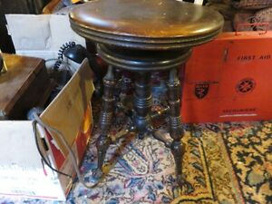 ANTIQUE SOLID WOOD PIANO STOOL WITH LION PAWS AND GLASS