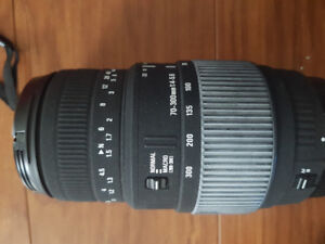 Like new telephoto Sigma 70-300mm lense.