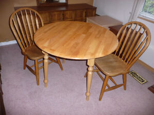 round wooden table w/ 2 drop leaves & 2 chairs