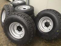 Tractor trailer wheels dump silage baler