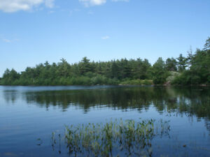 1500 FEET OF PRIVATE LAKE FRONT LAND