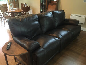Two leather sofas and lounge chair