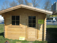 logs to build a house, garage  or shed