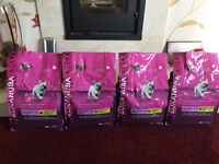 Case of 4 X 1kg Eukanuba small breed adult weight control dry food.