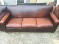 Brown leather sofa . Possible delivery