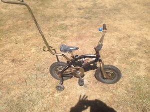 Tow madder bike with training wheels & removable handle