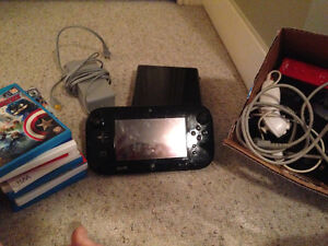 Excellent condition WiiU with games and remotes