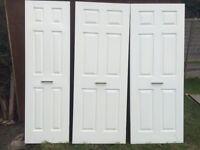 3 White panelled wooden doors