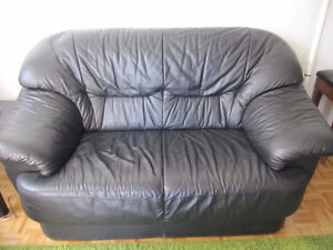 Black faux leather two seater couch