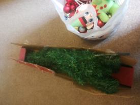 Medium size Christmas tree with bag of Christmas decorations FREE
