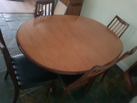 Dinning table and x6 leather chairs