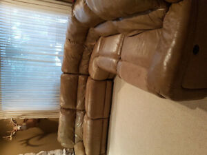 Free Tan Leather Sectional With Two Recliners.