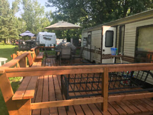 Trailer with deck and park fee pay already for the season