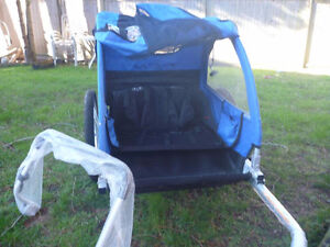 Barely used Blue CCM bicycle trailer, 2 seats for SALE